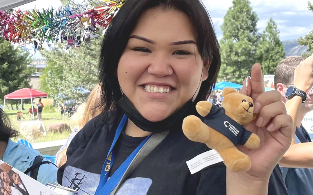 FLC student with Axis Care Hotline bear